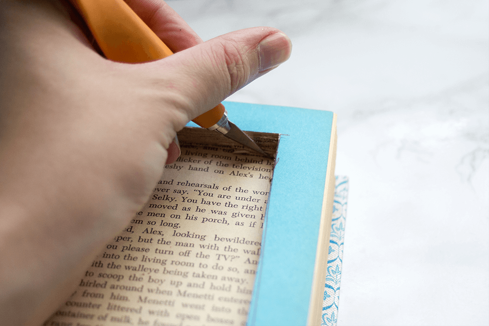 Looking to beautify your bedside table? Check out this easy-to-make DIY book safe and charging station! Click through to see how you can make your own!