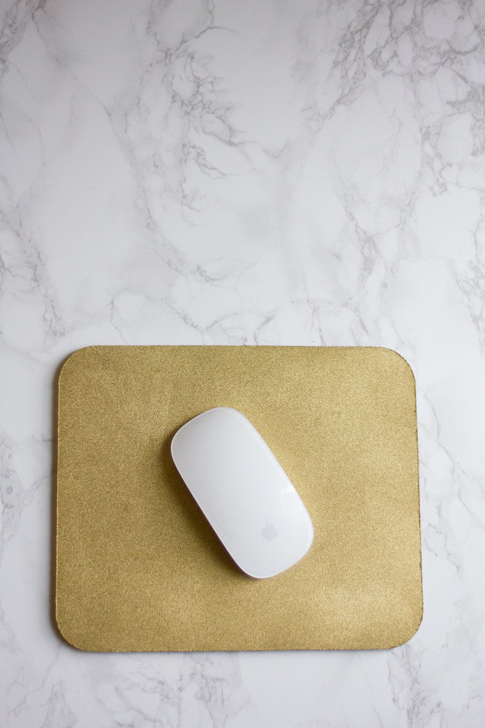 What do you do with free mouse pads? They're always so ugly, and who wants to be staring at a random logo all day? There's an easy solution — make a beautiful gold mouse pad out of it! Click through to find out how!